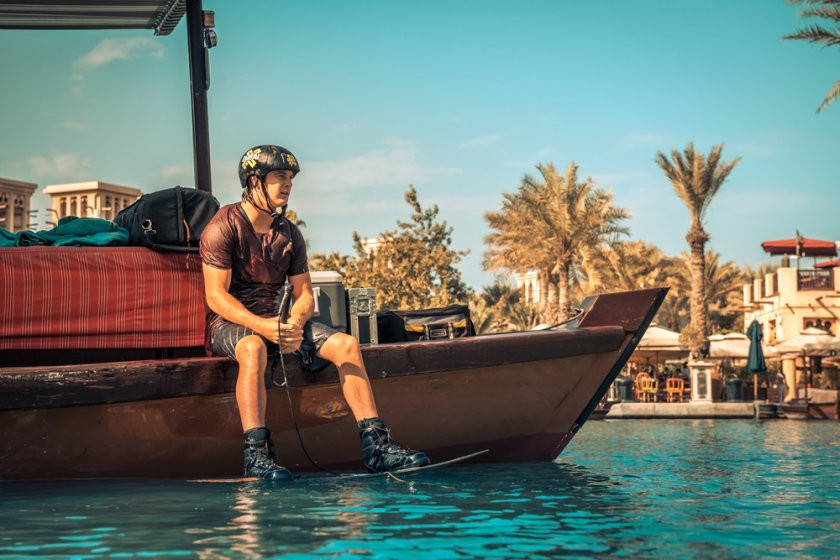 Rediscover Madinat - XDubai Athlete JB Oneill riding on an Abra boat on the waterways of Madinat Jumeirah